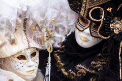 Venice, Italy. Carnival of Venice, beautiful masks at St. Mark`s Square stock photo