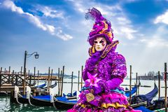 Venice, Italy - Carnival in Piazza San Marco. Venice, Italy, Carnival of Venice, beautiful mask at Piazza San Marco with gondolas and Grand Canal royalty free stock photos