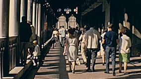 Venice aerial view. Venice, Italy - circa June 1967: Historical restored footage of San Marco church in Venice with San Marco square aerial view and tourists in stock footage