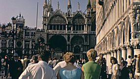 San Marco aerial view. Venice, Italy - circa June 1967: San Marco square in Venice aerial view and tourists in typical 60s clothes walking on the road stock video footage