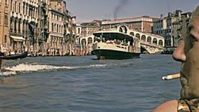 Canal Grande gondolas. Venice, Italy - circa June 1967: touristic trip of a family on the Venice Canal Grande canal by local gondola boat. Famous Ponte di Rialto stock video footage