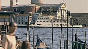Gondolas boats Venice. Venice, Italy - circa June 1967: tourists in typical 60s clothes and gondolas and boats in San Marco port of Venice with San Giorgio stock footage