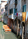 Venice Italy  clothes hanging and doors of the houses directly o Stock Photography