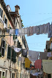 Venice Italy  clothes hanging and doors of the houses directly o Stock Photo
