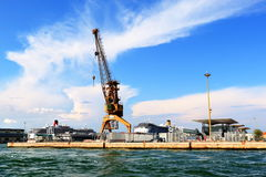 Venice, Italy. Crane for cargo vessels at the port. Venice, Italy - August 21, 2015: Crane for loading and unloading of cargo vessels at the port Royalty Free Stock Photo