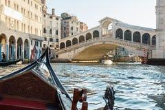 Sailing in a gondola on a Grand Channel in Venice towards the Ri. VENICE, ITALY - DECEMBER 30, 2016: Gondola sailing towards the Rialto bridge in Venice, Italy Stock Image