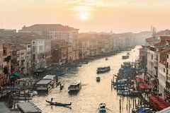 Setting sun over the Grand Canal with boats and gondolas in Venice Royalty Free Stock Images