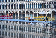VENICE,ITALY Empty St Mark`s Square during a flood with beautiful water reflections of historical buildings on wet f. VENICE,ITALY 01.12.2018. Empty St Mark`s royalty free stock images