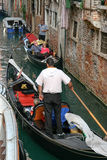 VENICE, ITALY/EUROPE - OCTOBER 26 : Barely enough room to pass i. N a Venetian canal in Venice on October 26, 2006. Unidentified people stock photos