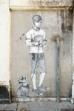 VENICE, ITALY/EUROPE - OCTOBER 12 : Painting of boy and dog on a. Wall in Venice Italy on October 12, 2014 Stock Photography