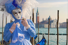 VENICE, ITALY - FEBRUARY 26, 2011: The blue mask from carnival and church San GIorgio Maggiore Royalty Free Stock Images