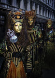 Venice Carnival nobility. Venice, Italy - 27 February, 2009:  brightly dressed up residents of Venice in costumes and masks during most significant festival of Royalty Free Stock Image