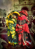 Two women at Venice Carnival. Venice, Italy - 27 February, 2009: brightly made-up residents of Venice wearing costumes and masks during most significant festival Royalty Free Stock Photography