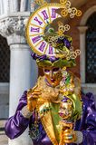 VENICE, ITALY - FEBRUARY 27, 2014: Carnival of Venice. Carnival mask with clock on his head on street during celebration of famous carnival of Venice stock photos