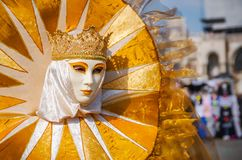 VENICE, ITALY - FEBRUARY 27, 2014: Carnival of Venice. Venetian masked model from Venice Carnival stock photography