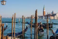 Venice, Italy, February 14, 2017. Venice City of Italy. gondolas parking dock, famous Venetian transport Stock Photo