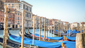 Venice, Italy - February 17, 2015:  Classical picture of the venetian canals with gondola across the canal. Royalty Free Stock Photos