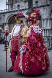 Couple with colorful Venetian costume and mask Royalty Free Stock Images