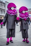 Couple with colorful Venetian costume and mask Stock Photo