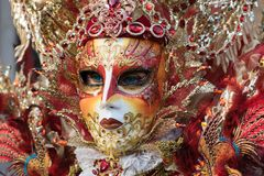 Venice, Italy - February 26, 2017: Famouse Venice Carnival. Mask. Ed woman in the crowd Royalty Free Stock Photography