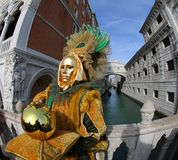 Venice, Italy - February 5, 2018: man with golden Costume royalty free stock images