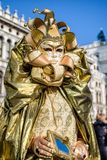 Person ingolden costume at The Carnival of Venice 2018 royalty free stock images