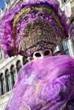 Person in violet costume at The Carnival of Venice 2018 royalty free stock photos