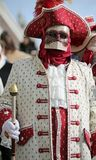 Venice, Italy - February 5, 2018: person with carnival mask and. Venice, Italy - February 5, 2018: person in costume with carnival mask and the ancient venetian Stock Photos