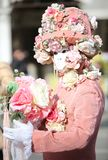 Venice, Italy - February 5, 2018: person with carnival mask and. Venice, Italy - February 5, 2018: person in costume with pink carnival mask Royalty Free Stock Images