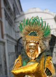 Venice, Italy - February 5, 2018: person with golden mask. Venice, Italy - February 5, 2018: person in costume with golden mask Stock Images