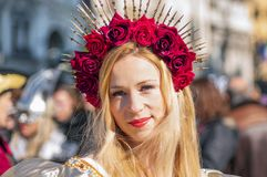 Young lady with red roses during Venetian carnival stock photos