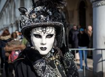 Portrait of woman wearing costume and mask on venetian Carnival. Stock Images