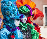 Disguised People. Venice, Italy- February 18th, 2012: Group of persons in traditional masks and cotumes during the Venice Carnival days Royalty Free Stock Photos