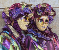 Disguised People. Venice, Italy- February 18th, 2012: Portrait of two persons in traditional masks and costumes during the Venice Carnival days Royalty Free Stock Image