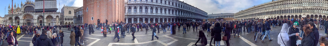 VENICE, ITALY - FEBRUARY 2015: Tourists in St Mark Square, panor Royalty Free Stock Photography