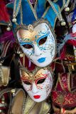 Carnivale Masks, Venice. Venice, Italy - February 28, 2015: Two carnivale masks stand out in a group of other masks in a store in Venice, Italy royalty free stock photo