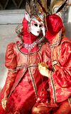 Venice, Italy - February 5, 2018: Two Lovers in Red Costume Mask Stock Image