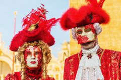 Disguised people at the Carnival of Venice. Venice, Italy - February 25, 2017: unidentified disguised people at the Carnival of Venice. The Carnival of Venice is Stock Photos