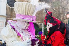 Disguised people at the Carnival of Venice. Venice, Italy - February 26, 2017: unidentified disguised people at the Carnival of Venice. The Carnival of Venice is Royalty Free Stock Photo