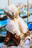 Disguised person at the Carnival of Venice. Venice, Italy - February 26, 2017: unidentified disguised person at the Carnival of Venice. The Carnival of Venice is Stock Photo