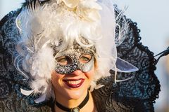 Disguised woman at the Carnival of Venice Stock Images