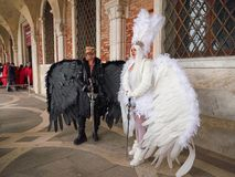 Angel and Lucifer at St. Mark`s Square in Venice, Italy stock image