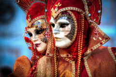 VENICE, ITALY - FEBRUARY 8: Unidentified people in Venetian mask Stock Photo