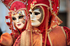 VENICE, ITALY - FEBRUARY 8: Unidentified people in Venetian mask. S at St. Mark's Square, Carnival of Venice on February 8, 2013. The annual carnival is from Royalty Free Stock Images