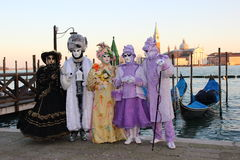 VENICE, ITALY - FEBRUARY 24, 2014: Unidentified person in Venetian masks at St. Marks Square Royalty Free Stock Photo