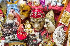 Venetian Carnivale Masks. Venice, Italy - February 27, 2015: In Venice, Italy in the evening a store sells Carnivale Masks and dolls royalty free stock image