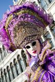 Woman in violet mask at The Carnival of Venice 2018 royalty free stock photos