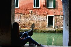The girl and the gondola royalty free stock photos