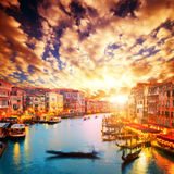 Venice, Italy. Gondola floats on Grand Canal. At romantic sunset. View from Rialto Bridge Royalty Free Stock Image