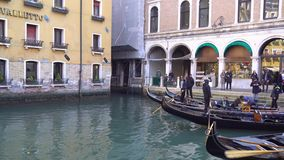 Venice, Italy - 14.03.2019: gondola with tourists in the narrow canals of Venice.  stock footage